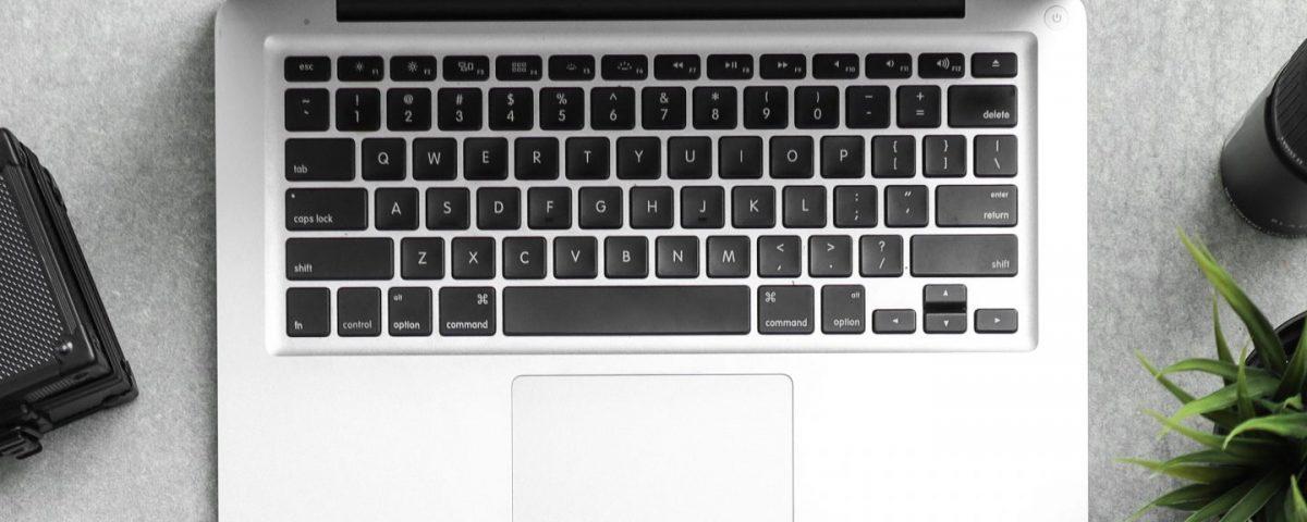 macbook pro beside dslr camera and mug 3568521 e1596203106952